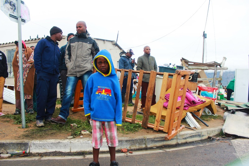 A child is left homeless after the evictions in Lwandle. (Ra'eesa Pather)