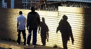 Men walking on SA street [Flickr