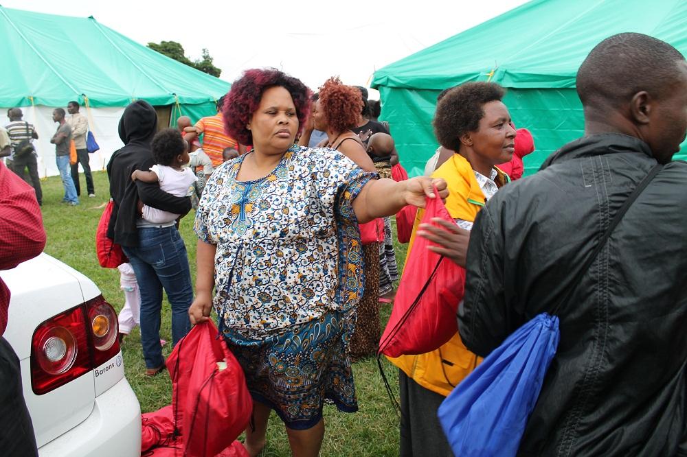 Mrs Mkhize handing sanitary parcels