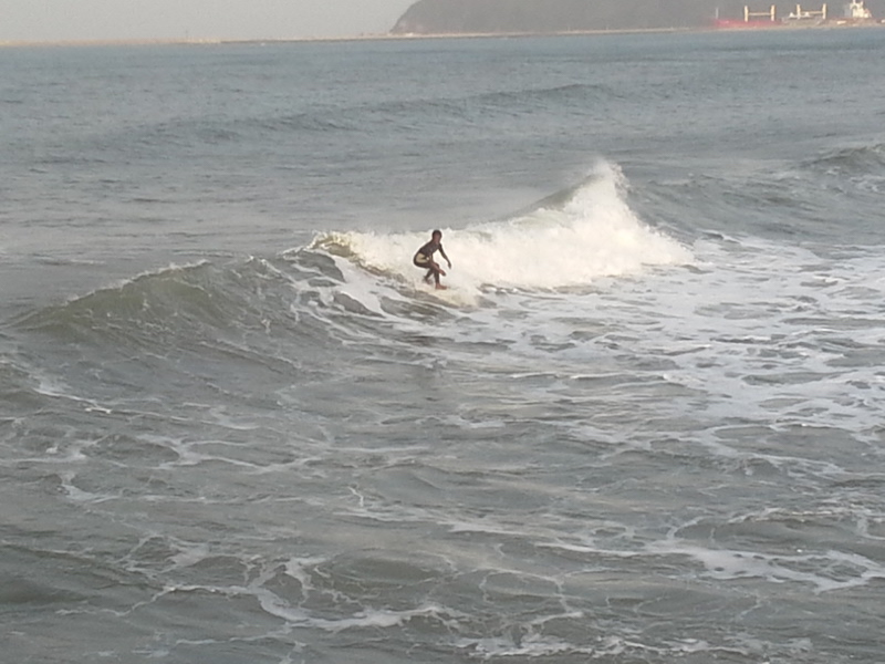 Andile Zulu surfing at Point beach