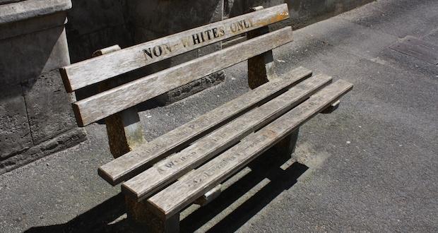 Non whites only bench apartheid [wikimedia]