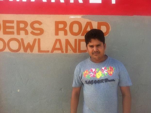 Shopowner Kabir Bhuiyan outside his shop in Meadowlands