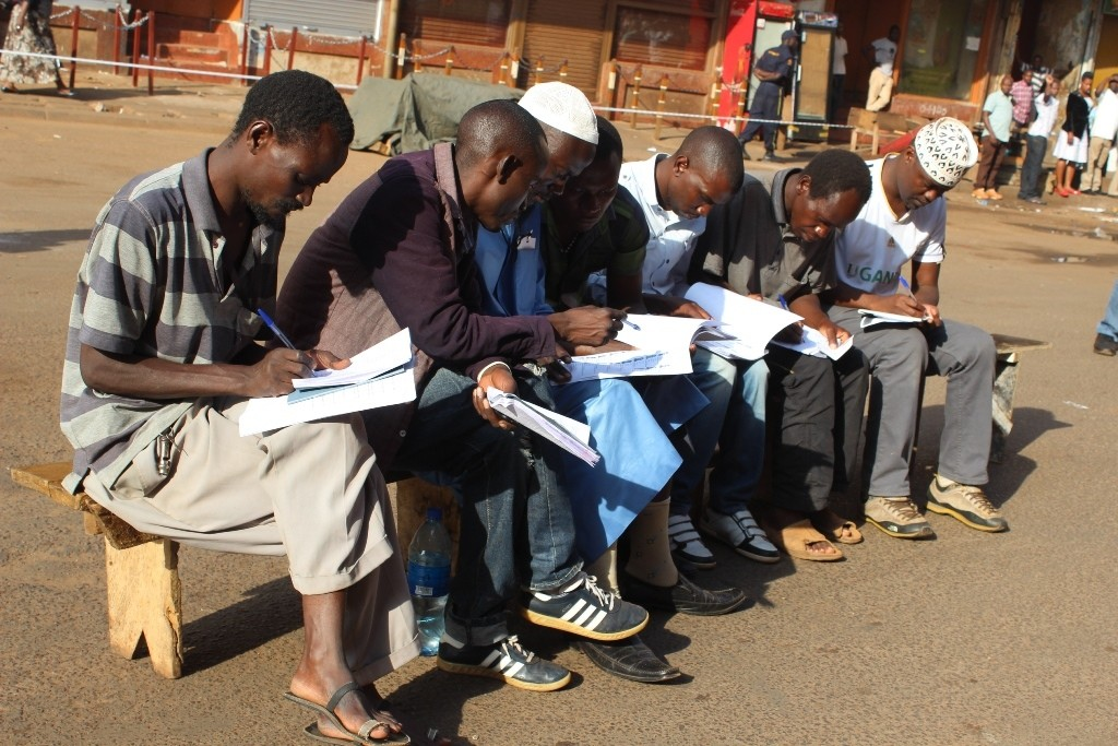 Political party polling agents at People's Plaza in downtown Kampala struggling to find voter's names on the register.