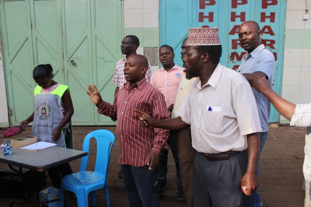 Angry voters at Superior Complex argue with officials and police over the later delay of voting materials.