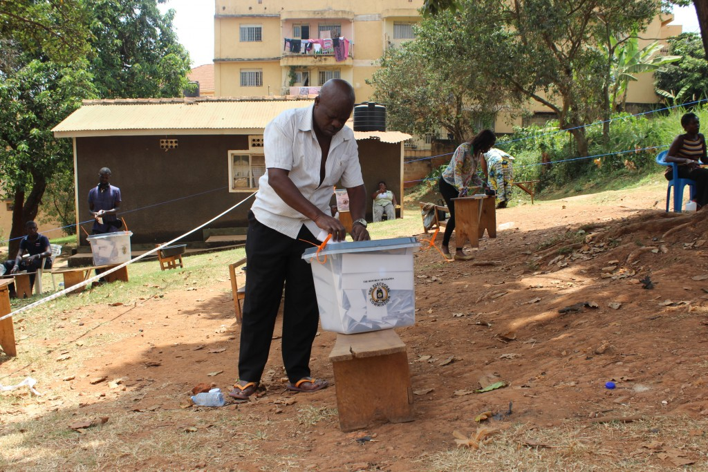 A voter in Mengo, Kampala casts his vote after a grenade exploded here the night before the vote. Mengo has been fairly peaceful and voting began on time however, police are still investigating the explosion which resulted in the death of at least 3 people.