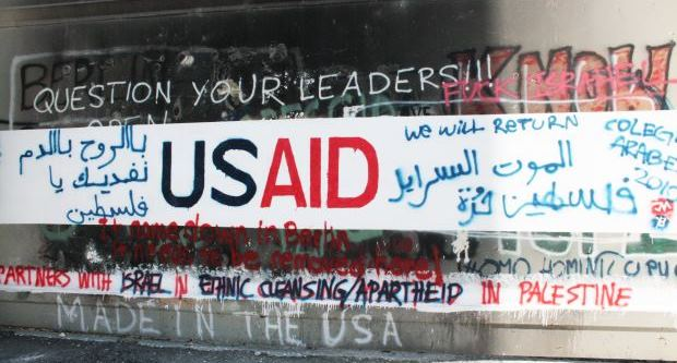 [slider] IAW 2016 pics graffiti on separation barrier USAID