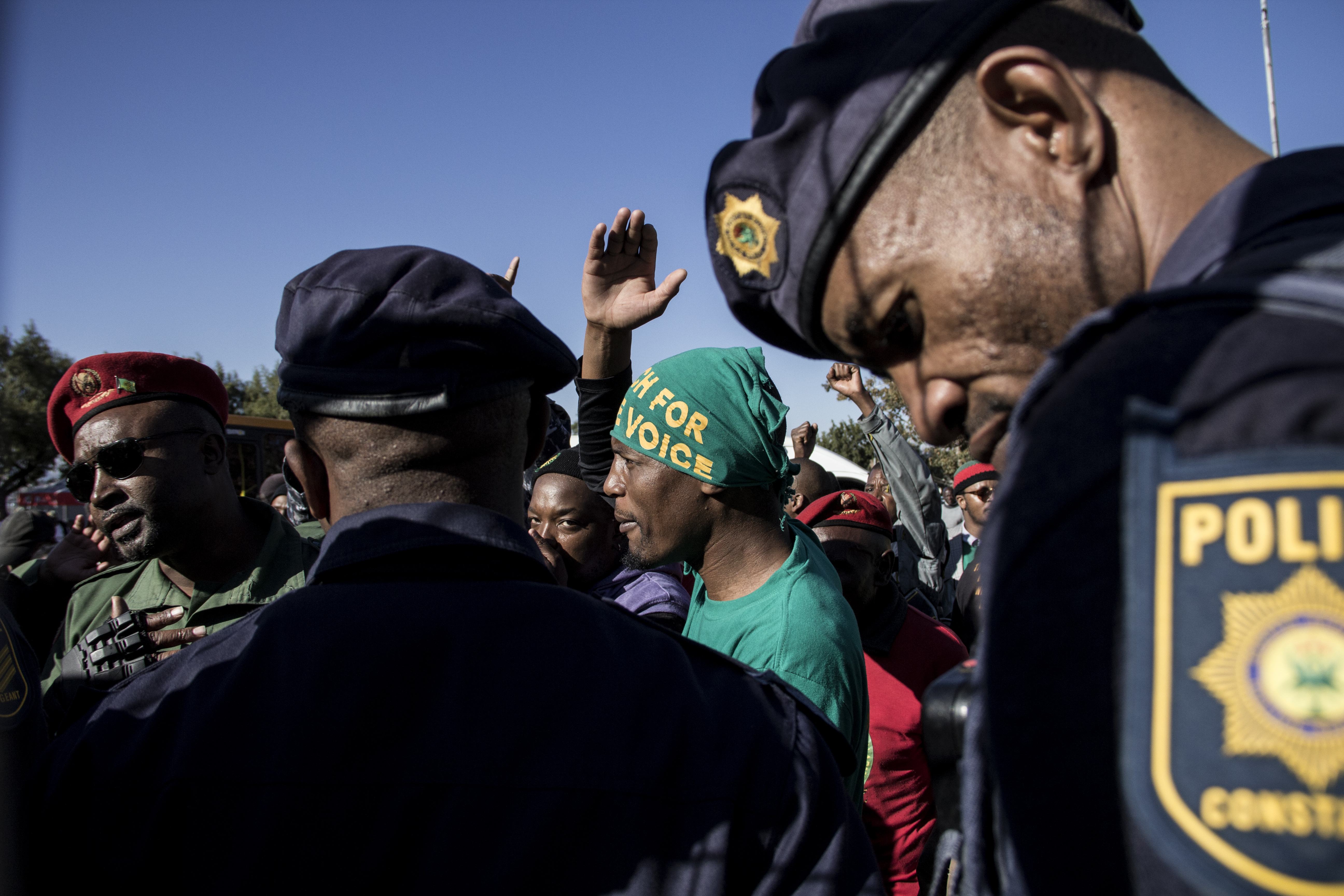 Police prevent protesting Pan African Congress (PAC) members from entering the Hector Pietersen Memorial Site in Soweto on June 16 2016.