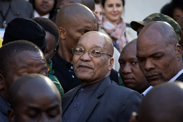 President Jacob Zuma, surrounded by bodyguards, at the ANC Youth Day memorial event at Orlando Stadium.