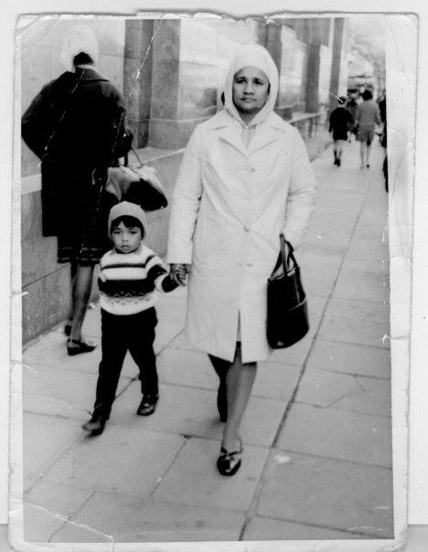 Five years old, walking with my mom down Darling Street in Cape Town.