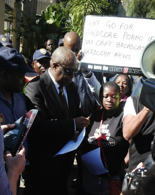 SABC spokesperson accepting the memorandum on behalf of the SABC