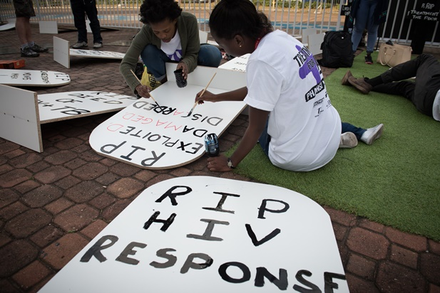 Activists in the Global Village prepare for a demonstration. Photo ©International AIDS Society/Marcus Rose