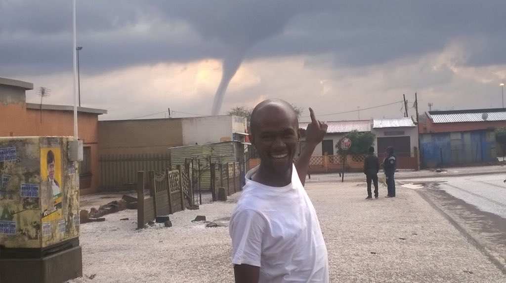 This image, shared widely on social media, of a man pointing at the tornado in the distance, has already become iconic.