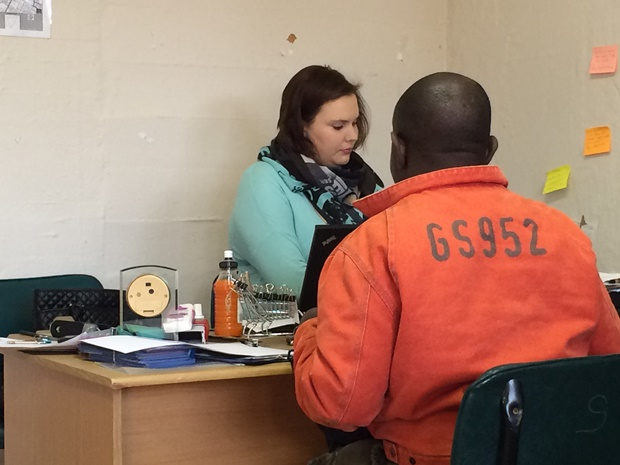 DA councillor Nicole Graham assisiting a community member with a proof of address letter