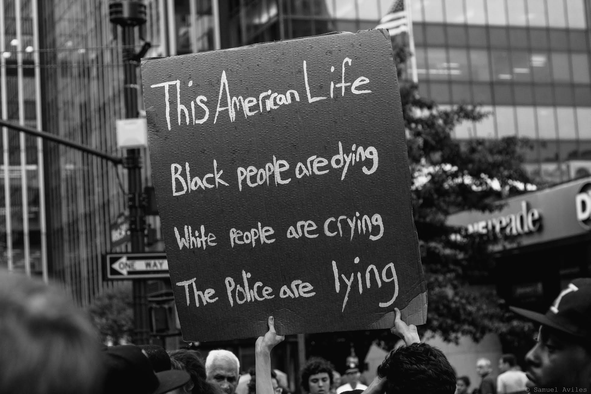 Sign at the July 7th protest against police brutality in Manhattan, New York. The sign references the innocent black people killed by police.