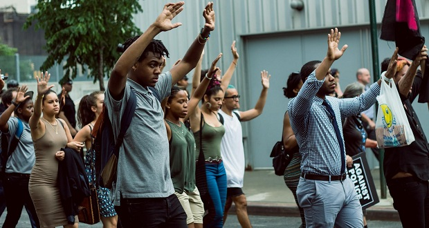 "Protestors hold up their hands during the ""hands up, don't shoot"" chant on July 7th, in Manhattan, New York. The march went through most major areas in Manhattan."