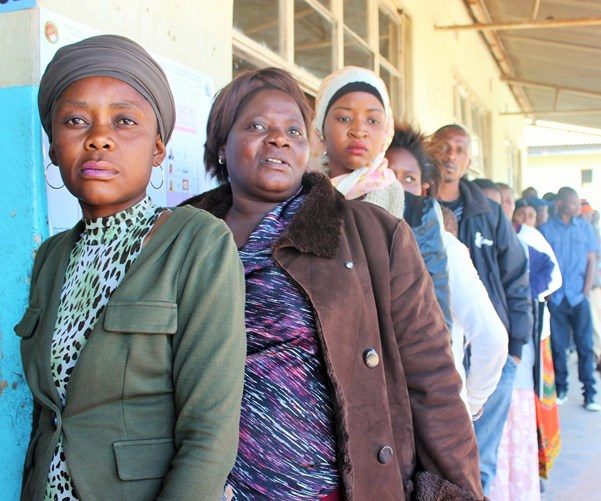 Women with voices: female voters queue up in their own line to cast their ballots at Chawama Primary School in south western Lusaka. Chawama is a consituency held by President Lungu and it was also the area where inter-party clashes led to campaigns being suspended for 10 days in June and July.
