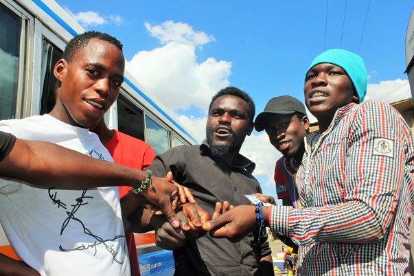 Cast thumbs up: Young voters outside Ahmadiya Muslim School, Kanyama, western Lusaka, show off their inked thumbs.