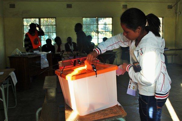 An early morning voter places her choice for president in the ballot box at Vera Chiluba Secondary School in Mtendere, eastern Lusaka where spiking pre-poll tensions caused concern over the peacefulness of the vote.
