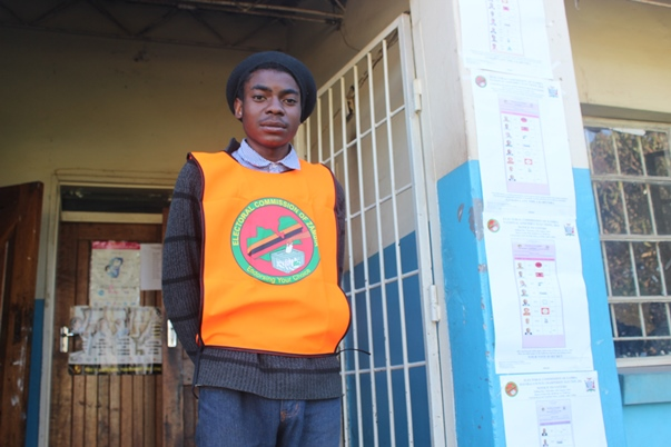 On the lookout: A first-time polling agent gave up his right to vote so others could do so at Vera Chiluba Secondary School in Mtendere, eastern Lusaka