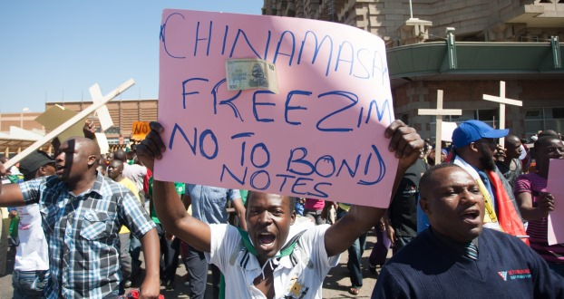a protestor holds a placard