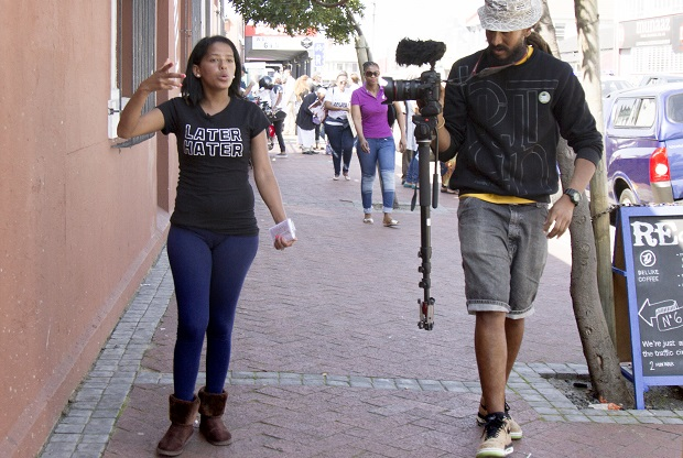 Charnell Commando speaks to Kurt Orderson after Bromwell Street residents occupied the Old Biscuit Mill.