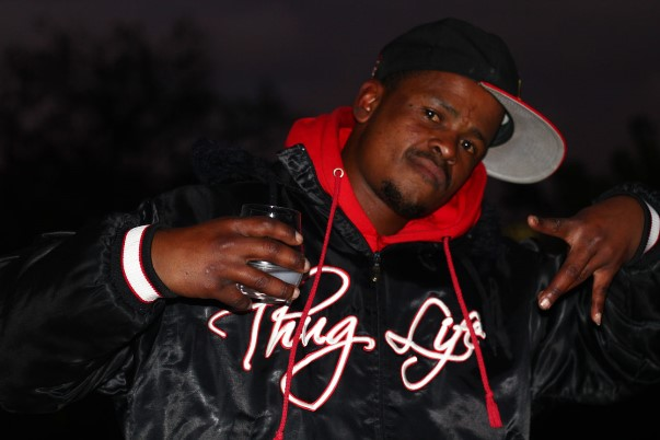 Former member of the Mongrels gang and aspiring rapper, Gordon, wearing a jacket glorifying Shakur's 'thug' lifestyle. Shakur is Gordon's most important musical influence. Two years ago, Gordon left gang life through Hanover Park's Ceasefire project. The project employs ex-gangsters to mediate gang disputes and to encourage and support gang members to leave and stay out of gangs.