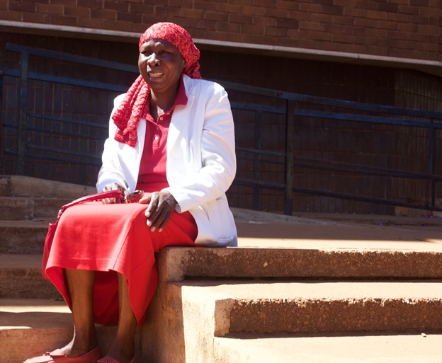 Lilian Chinyerere, a 62 year old supporter of the opposition Movement for Democratic Change (MDC-T) weeps on the steps of Rotten Row Magistrates court after being hit by police as protesters waited to hear the outcome of the court clearance.
