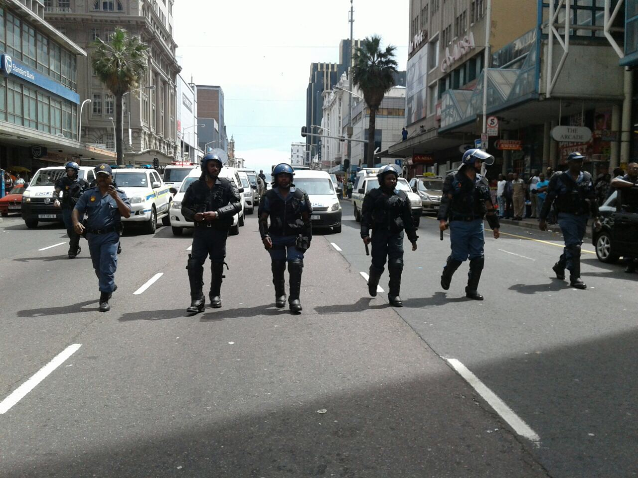 Police escorting students to City Hall. #KZNFMF