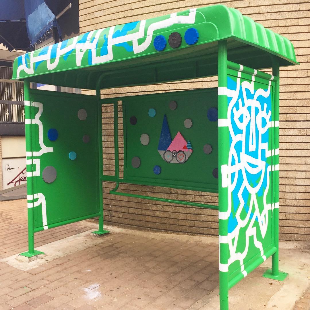 Green bus shelter